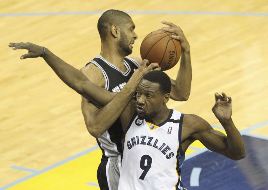Spurs' Tim Duncan (21) and Memphis Grizzlies' Tony Allen (09) get tangled for a rebound in Game 4 of the 2013 Western Conference Finals at the FedEx Forum in Memphis on Monday, May 27, 2013. (Kin Man Hui/San Antonio Express-News)