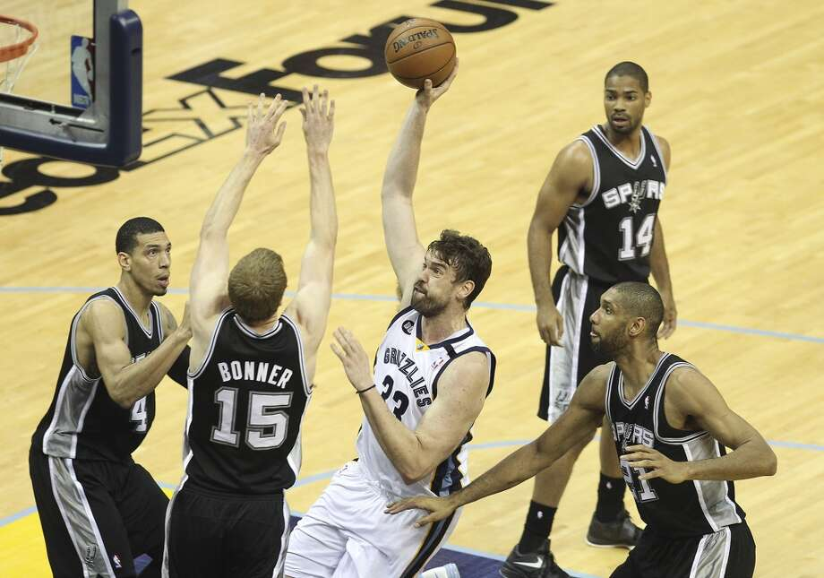 Memphis Grizzlies' Marc Gasol (33) drives for a shot against Spurs' Matt Bonner (15), Danny Green (04) and Tim Duncan (21) in Game 4 of the 2013 Western Conference Finals at the FedEx Forum in Memphis on Monday, May 27, 2013. (Kin Man Hui/San Antonio Express-News)