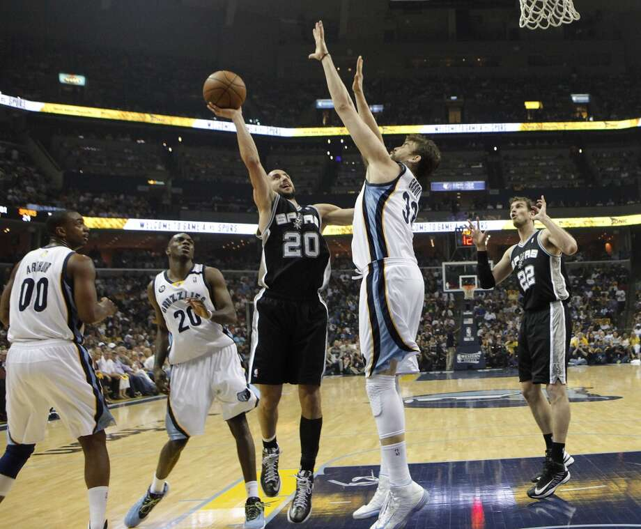 Spurs' Manu Ginobili (20) attempts a shot over Memphis Grizzlies' Marc Gasol (33) in Game 4 of the 2013 Western Conference Finals at the FedEx Forum in Memphis on Monday, May 27, 2013. (Kin Man Hui/San Antonio Express-News)