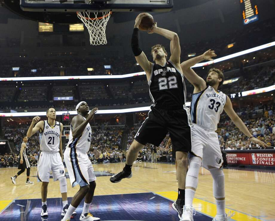 Spurs' Tiago Splitter (22) goes up for a shot against Memphis Grizzlies' Marc Gasol (33) in Game 4 of the 2013 Western Conference Finals at the FedEx Forum in Memphis on Monday, May 27, 2013. (Kin Man Hui/San Antonio Express-News)