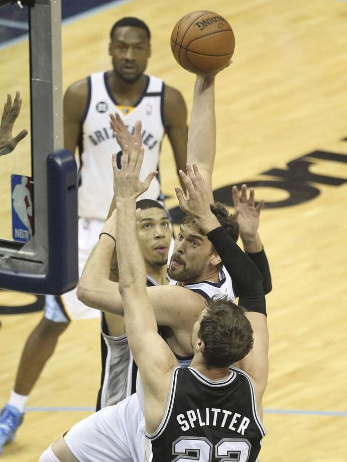 Memphis Grizzlies' Marc Gasol (33) goes up for a shot against Spurs' Tiago Splitter (22) and Danny Green (04) in Game 4 of the 2013 Western Conference Finals at the FedEx Forum in Memphis on Monday, May 27, 2013. (Kin Man Hui/San Antonio Express-News)