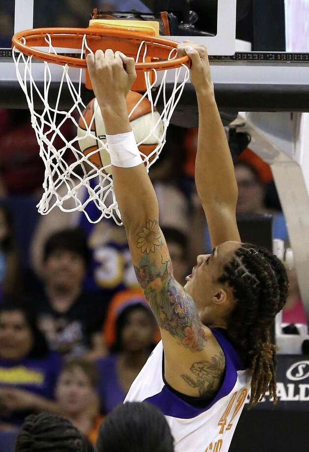 Brittney Griner had two dunks, but her WNBA debut ended in a loss. Photo: Ross D. Franklin, STF / AP