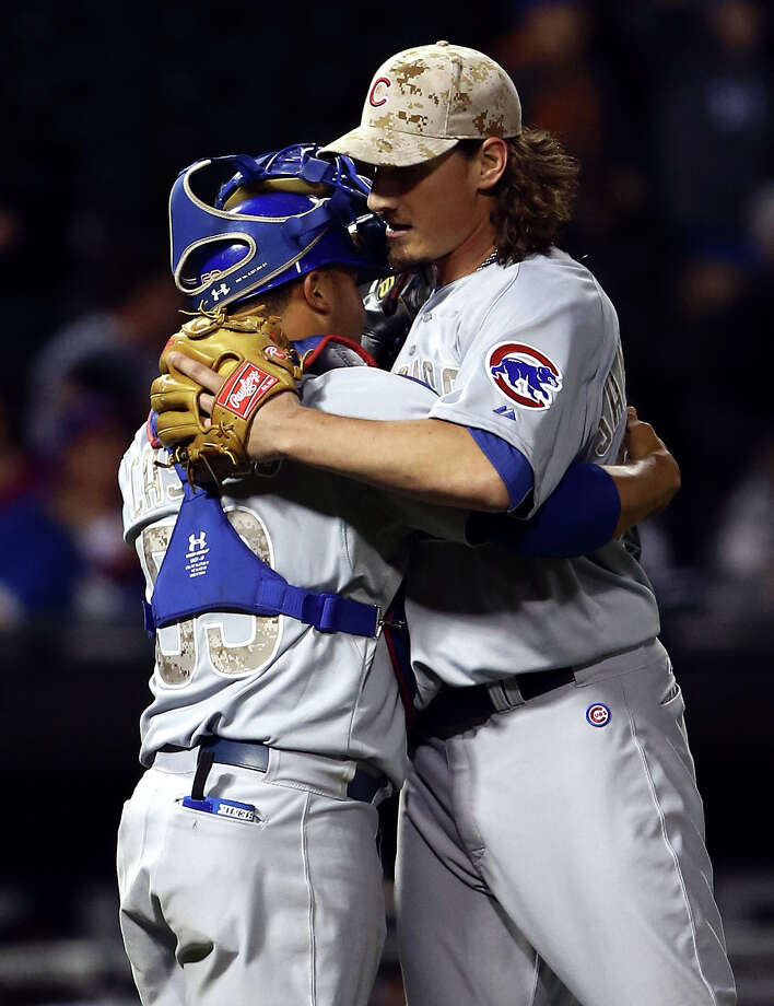 Chicago Cubs pitcher Jeff Samardzija hugs catcher Wellington Castillo after pitching a complete game two hitter as the Cubs beat the Chicago White Sox 7-0 in a baseball game in Chicago on Monday, May 27, 2013. (AP Photo/Charles Cherney) Photo: Charles Cherney