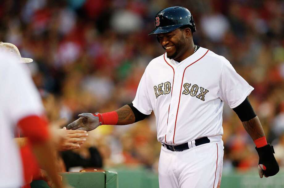 BOSTON, MA - MAY 27: David Ortiz #34 of the Boston Red Sox is congratulated by teammates in the dugout after scoring on a ground rule double in the third inning against the Philadelphia Phillies during the interleague game on May 27, 2013 at Fenway Park in Boston, Massachusetts. (Photo by Jared Wickerham/Getty Images) Photo: Jared Wickerham