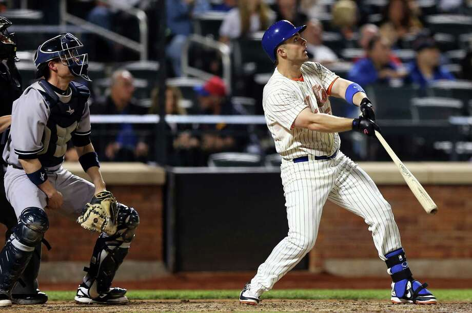 NEW YORK, NY - MAY 27:  David Wright #5 of the New York Mets watches his solo home run as Chris Stewart #19 of the New York Yankees watches in the seventh inning on May 27, 2013 at Citi Field in the Flushing neighborhood of the Queens borough of New York City. Both the New York Mets and the New York Yankees are wearing special uniforms to commemorate Memorial Day.  (Photo by Elsa/Getty Images) Photo: Elsa