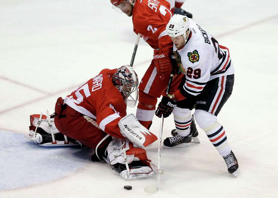 Chicago's Bryan Bickell (29) shoots the puck past Detroit goalie Jimmy Howard (35) in the third period of the Blackhawks' Game 6 victory Monday night. Photo: Carlos Osorio, STF / AP