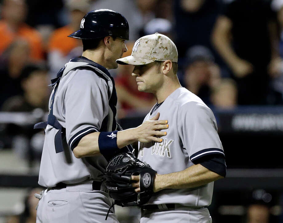 New York Yankees catcher Chris Stewart (19) consoles New York Yankees relief pitcher David Robertson after Robertson allowed an RBI single to New York Mets Daniel Murphy in an interleague baseball game at Citi Field in New York, Monday, May 27, 2013. Photo: Kathy Willens