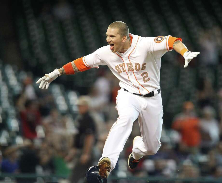 Brandon Barnes could not contain himself after his ground-rule double in the 12th inning gave the Astros the victory. Photo: Karen Warren, Staff / © 2013 Houston Chronicle