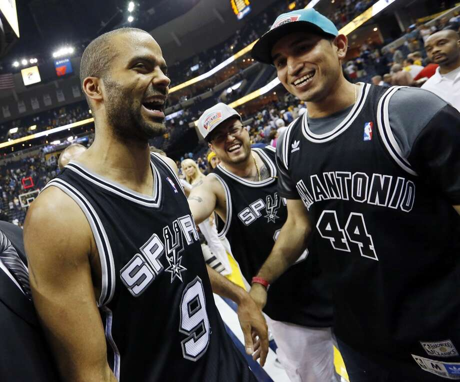 San Antonio Spurs' Tony Parker celebrates with fans after Game 4 of the 2013 Western Conference finals against the Memphis Grizzlies Monday May 27, 2013 at the FedEx Forum in Memphis, Tenn. The Spurs won 93-86.