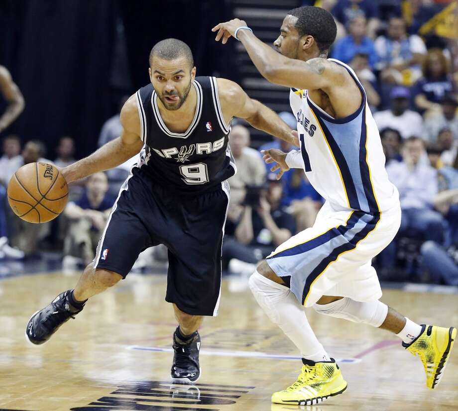 San Antonio Spurs' Tony Parker looks for room around Memphis Grizzlies' Mike Conley during second half action Game 4 of the 2013 Western Conference finals against the Memphis Grizzlies Monday May 27, 2013 at the FedEx Forum in Memphis, Tenn. The Spurs won 93-86.