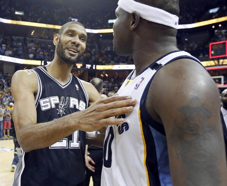 San Antonio Spurs' Tim Duncan talks with Memphis Grizzlies' Zach Randolph after Game 4 of the 2013 Western Conference finals against the Memphis Grizzlies Monday May 27, 2013 at the FedEx Forum in Memphis, Tenn. The Spurs won 93-86.