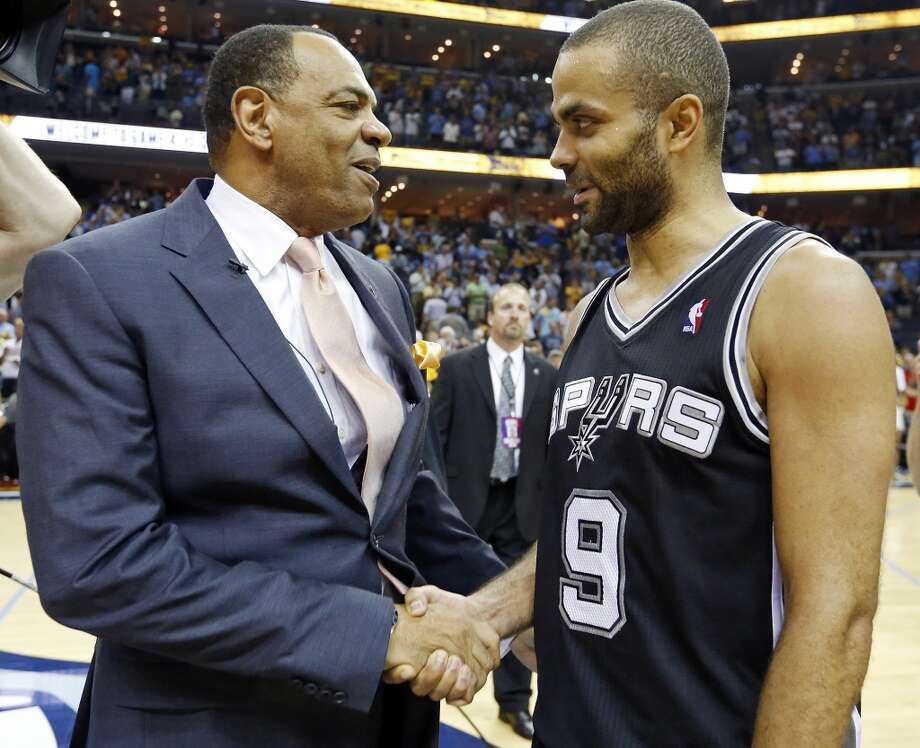Memphis Grizzlies head coach Lionel Hollins talks with San Antonio Spurs' Tony Parker after Game 4 of the 2013 Western Conference finals against the Memphis Grizzlies Monday May 27, 2013 at the FedEx Forum in Memphis, Tenn. The Spurs won 93-86.