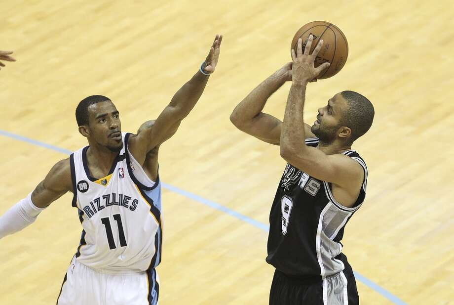 Spurs' Tony Parker (09) takes a shot against Memphis Grizzlies' Mike Conley (11) in Game 4 of the 2013 Western Conference Finals at the FedEx Forum in Memphis on Monday, May 27, 2013. (Kin Man Hui/San Antonio Express-News)