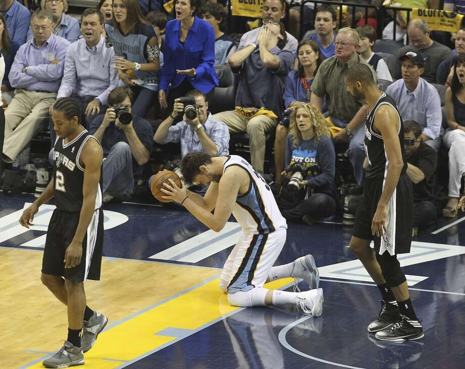 Memphis Grizzlies' Marc Gasol (33) falls to his knees after a missed play against the Spurs in Game 4 of the 2013 Western Conference Finals at the FedEx Forum in Memphis on Monday, May 27, 2013. (Kin Man Hui/San Antonio Express-News)