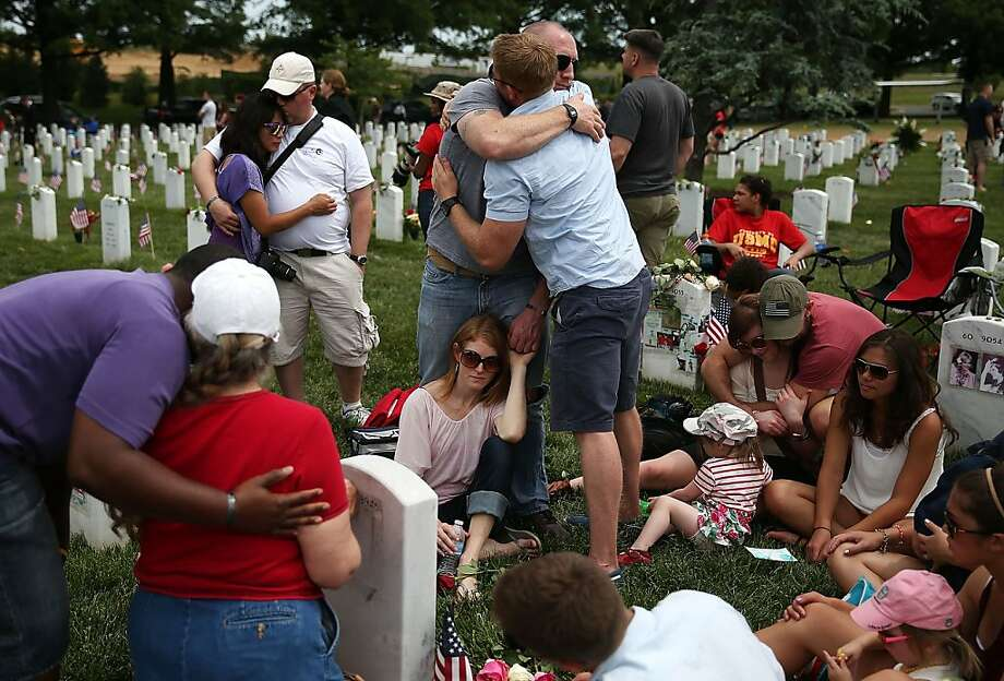 ARLINGTON, VA - MAY 27: Friends and family gather around the gravesite of fallen soldier U.S. Army Capt. Ronald George Luce Jr. who was was killed in Afghanistan, in section 60 at Arlington Cemetery, May 27, 2013 in Arlington, Virginia. For Memorial Day President Obama layed a wreath at the Tomb of the Unknowns, paying tribute to military veterans past and present who have served and sacrificed their lives for their country.  (Photo by Mark Wilson/Getty Images) Photo: Mark Wilson, Getty Images