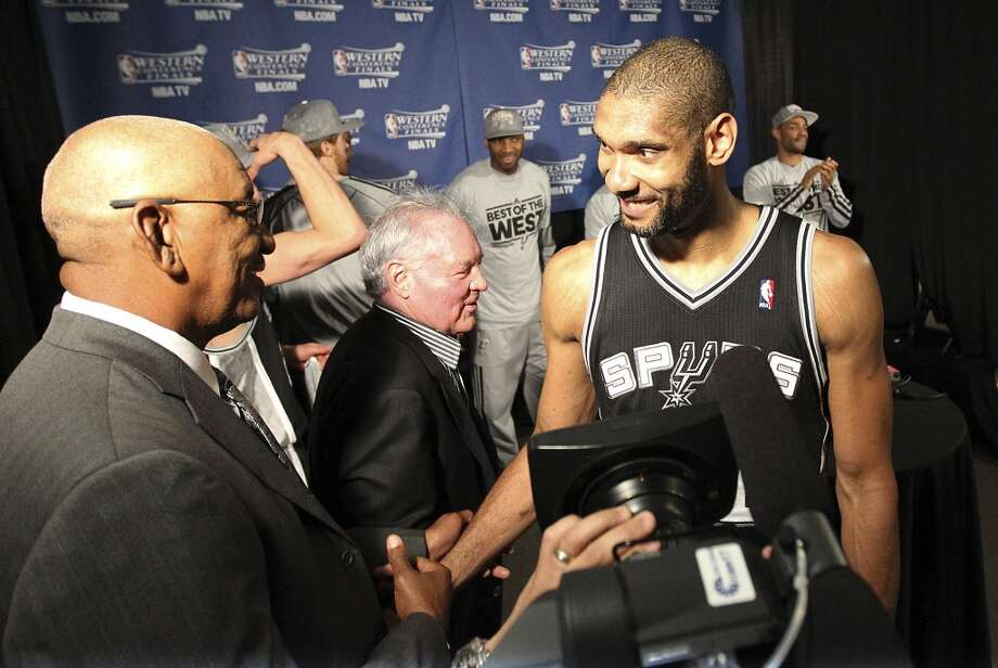 Tim Duncan (right) gets congratulated by Spurs legend George Gervin as they along with Spurs owner Peter Holt wait to accept the 2013 Western Conference Championship trophy after defeating the Memphis Grizzlies in four games at the FedEx Forum in Memphis on Monday, May 27, 2013. (Kin Man Hui/San Antonio Express-News)