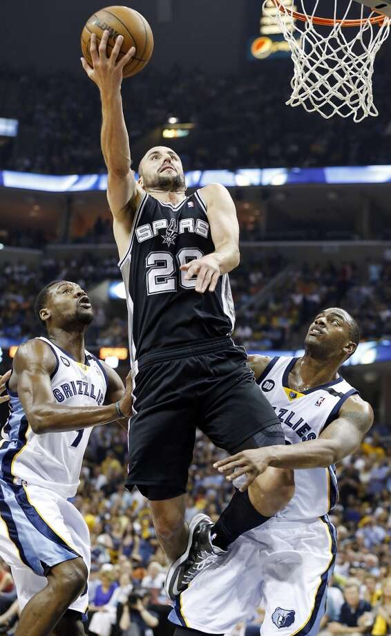 San Antonio Spurs' Manu Ginobili shoots between during second half action Game 4 of the 2013 Western Conference finals against the Memphis Grizzlies Monday May 27, 2013 at the FedEx Forum in Memphis, Tenn. The Spurs won 93-86.