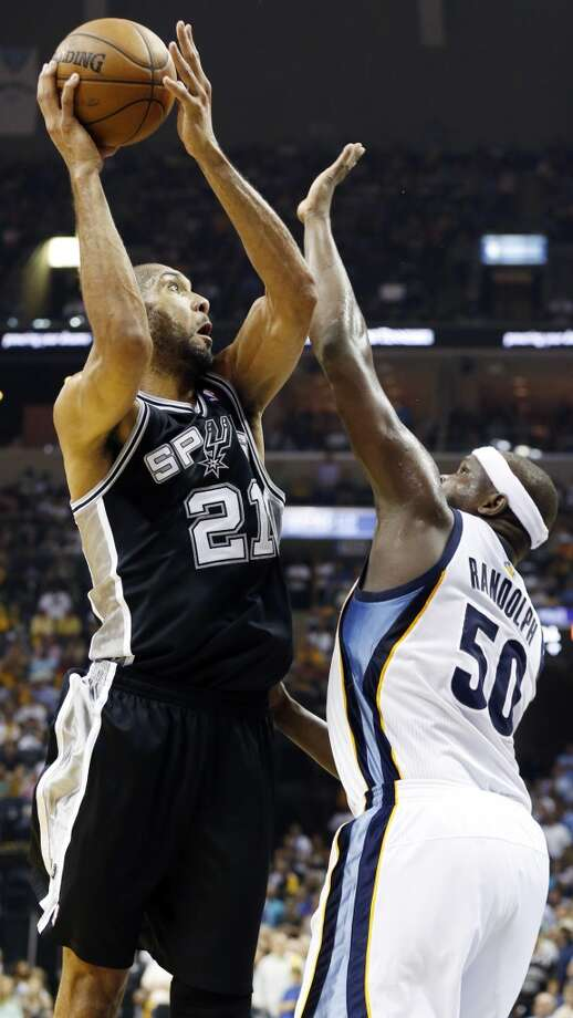 San Antonio Spurs' Tim Duncan shoots around Memphis Grizzlies' Zach Randolph during second half action Game 4 of the 2013 Western Conference finals against the Memphis Grizzlies Monday May 27, 2013 at the FedEx Forum in Memphis, Tenn. The Spurs won 93-86.