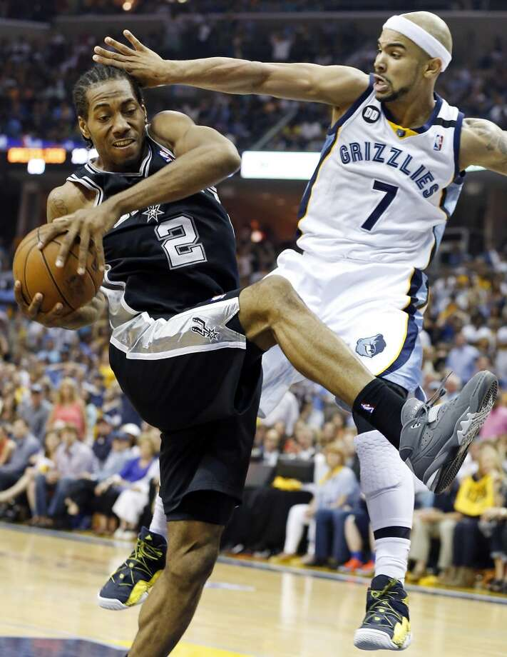 San Antonio Spurs' Kawhi Leonard looks for room around Memphis Grizzlies' Jerryd Bayless during second half action Game 4 of the 2013 Western Conference finals against the Memphis Grizzlies Monday May 27, 2013 at the FedEx Forum in Memphis, Tenn. The Spurs won 93-86.
