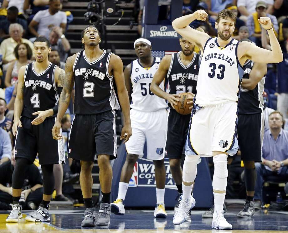 Memphis Grizzlies' Marc Gasol reacts after a play as San Antonio Spurs' Kawhi Leonard looks on during second half action Game 4 of the 2013 Western Conference finals Monday May 27, 2013 at the FedEx Forum in Memphis, Tenn. The Spurs won 93-86.