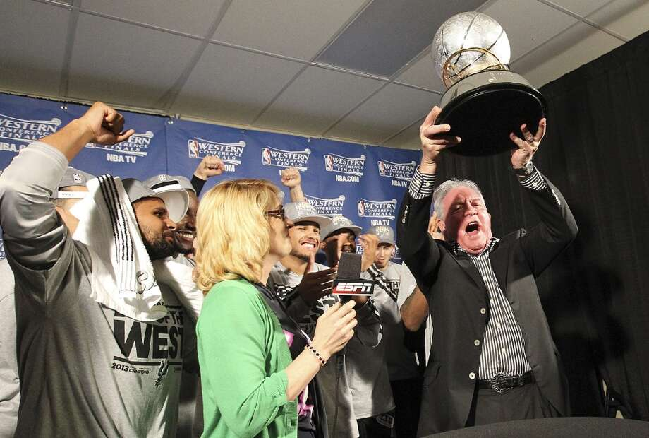 Spurs owner Peter Holt lifts the 2013 Western Conference Championship trophy after the Spurs defeated the Memphis Grizzlies in four games at the FedEx Forum in Memphis on Monday, May 27, 2013. (Kin Man Hui/San Antonio Express-News)