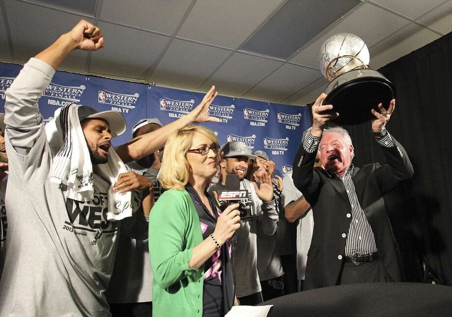 Spurs owner Peter Holt holds up the 2013 Western Conference Championship trophy as the Spurs including Patty Mills (left) celebrate after defeating the Memphis Grizzlies in four games at the FedEx Forum in Memphis on Monday, May 27, 2013. (Kin Man Hui/San Antonio Express-News)