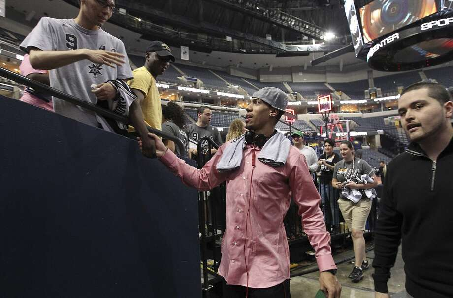 Spurs' Danny Green shakes hands with fans after the Spurs defeated the Memphis Grizzlies at the FedEx Forum in Memphis to take the 2013 Western Conference title in four games on Monday, May 27, 2013. (Kin Man Hui/San Antonio Express-News)