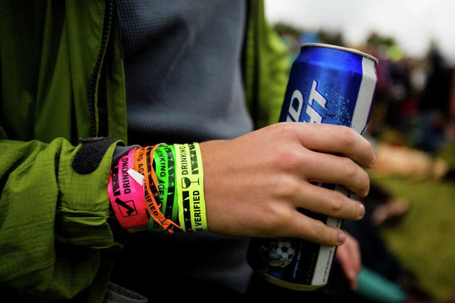 Many attendees sported the colorful bands serving as proof of four days worth of drinking on the final day of the annual Sasquatch music festival Monday, May 27, 2013, at The Gorge Amphitheatre in George. Photo: JORDAN STEAD, SEATTLEPI.COM / SEATTLEPI.COM
