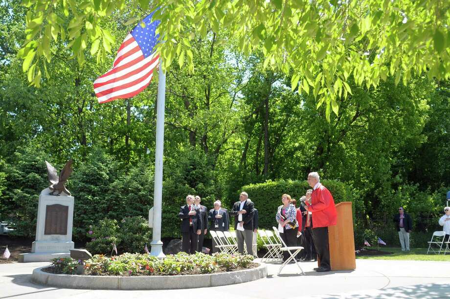 Officials with the Town of Colonie and with the Italian Benevolent Society and Ladies Auxiliary, stand for the playing of the Star-Spangled Banner at West Albany Memorial Park during the 14th annual wreath laying ceremony put on by the Italian Benevolent Society and Ladies Auxiliary on Monday, May 27, 2013 in Albany, NY.   (Paul Buckowski / Times Union) Photo: Paul Buckowski