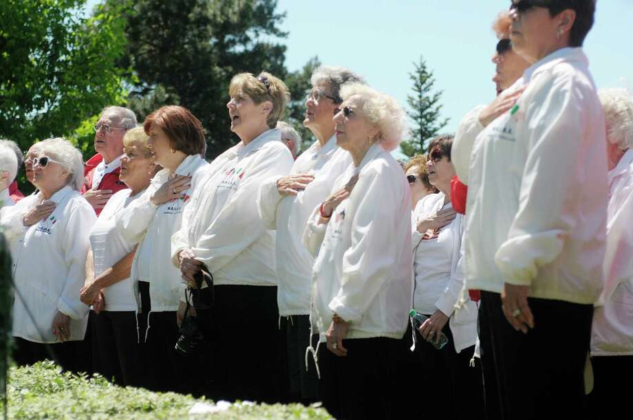 Members of the Ladies Auxiliary of the Italian Benevolent Society sing the Star-Spangled Banner at West Albany Memorial Park during the 14th annual wreath laying ceremony put on by the Italian Benevolent Society and Ladies Auxiliary on Monday, May 27, 2013 in Albany, NY.   (Paul Buckowski / Times Union) Photo: Paul Buckowski