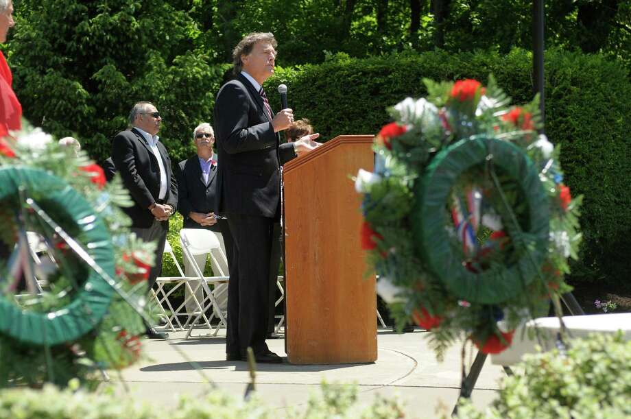 Colonie Town Justice, Peter Crummey, addresses those gathered at West Albany Memorial Park during the 14th annual wreath laying ceremony put on by the Italian Benevolent Society and Ladies Auxiliary on Monday, May 27, 2013 in Albany, NY.   (Paul Buckowski / Times Union) Photo: Paul Buckowski