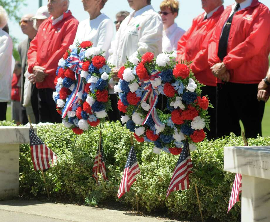 Wreaths were placed at the veterans memorials  at West Albany Memorial Park during the 14th annual wreath laying ceremony put on by the Italian Benevolent Society and Ladies Auxiliary on Monday, May 27, 2013 in Albany, NY.   (Paul Buckowski / Times Union) Photo: Paul Buckowski