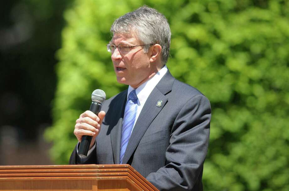 State Assemblyman Phil Steck addresses those gathered at West Albany Memorial Park during the 14th annual wreath laying ceremony put on by the Italian Benevolent Society and Ladies Auxiliary on Monday, May 27, 2013 in Albany, NY.   (Paul Buckowski / Times Union) Photo: Paul Buckowski