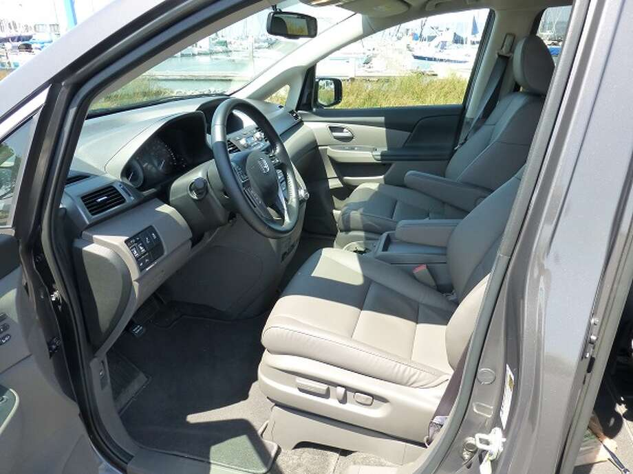 There are 11 cup holders sprinkled around the interior of this minivan, as well as a pop-down DVD screen.