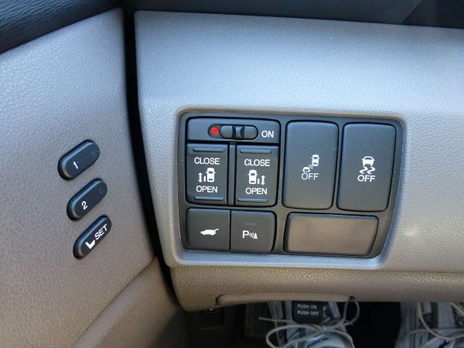 Buttons  on the left side of the dashboard allow the driver to control opening and closing of the rear side doors.
