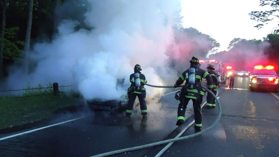 A car fire on Route 15 northbound closes both lanes Monday night. Photo: Contributed Photo / Connecticut Post Contributed