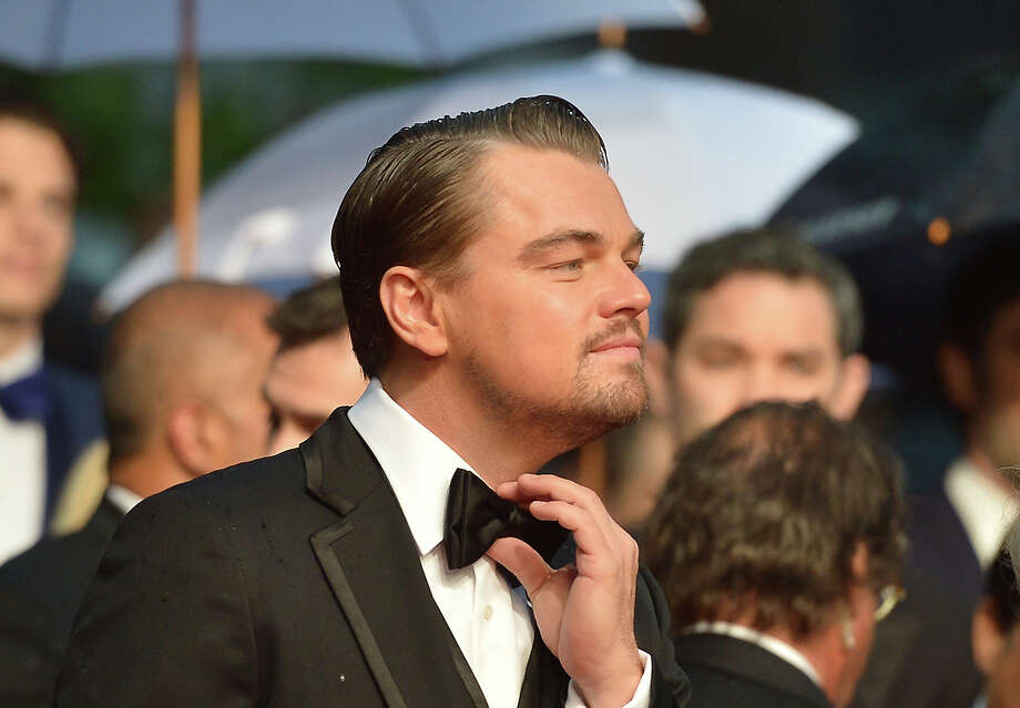 "US actor Leonardo DiCaprio adjusts his bow tie on May 15, 2013 as he arrives for the screening of the film ""The Great Gatsby"" ahead of the opening of the 66th edition of the Cannes Film Festival in Cannes. Cannes, one of the world's top film festivals, opens on May 15 and will climax on May 26 with awards selected by a jury headed this year by Hollywood legend Steven Spielberg. Photo: ALBERTO PIZZOLI, AFP/Getty Images / 2013 AFP"