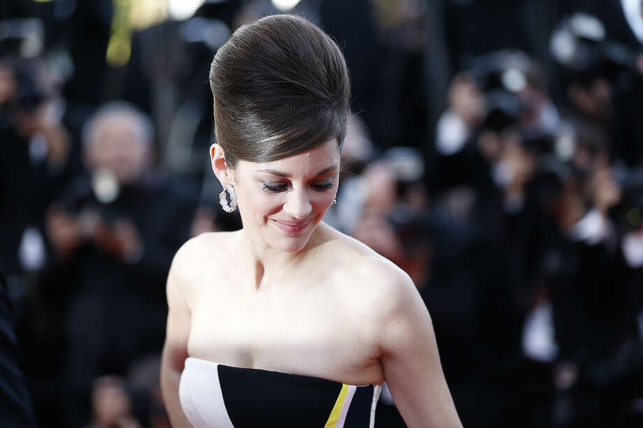 """French actress Marion Cotillard poses on May 20, 2013 as she arrives for the screening of the film """"Blood Ties"""" presented Out of Competition at the 66th edition of the Cannes Film Festival in Cannes. Cannes, one of the world's top film festivals, opened on May 15 and will climax on May 26 with awards selected by a jury headed this year by Hollywood legend Steven Spielberg. Photo: VALERY HACHE, AFP/Getty Images / 2013 AFP"""