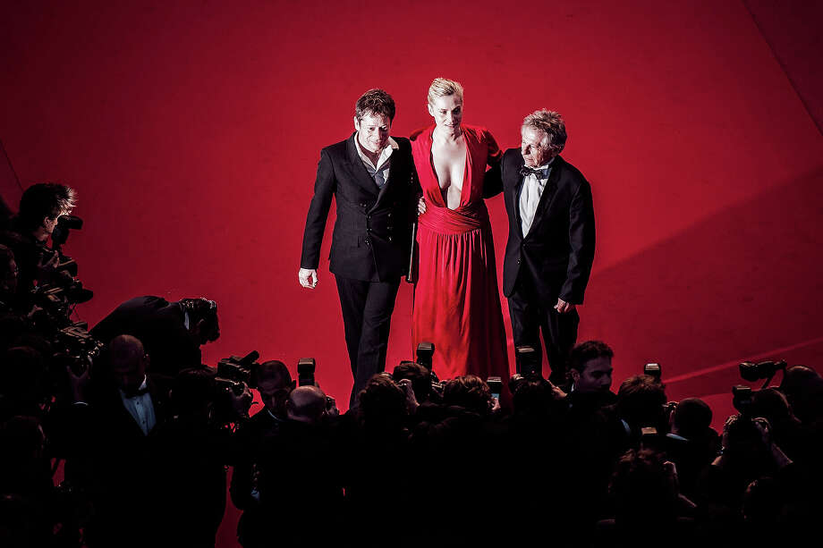 Actors Mathieu Amalric, Emmanuelle Seigner and director Roman Polanski attend the 'La Venus A La Fourrure' premiere during The 66th Annual Cannes Film Festival on May 25, 2013 in Cannes, France. Photo: Francois Durand, Getty Images / 2013 Getty Images
