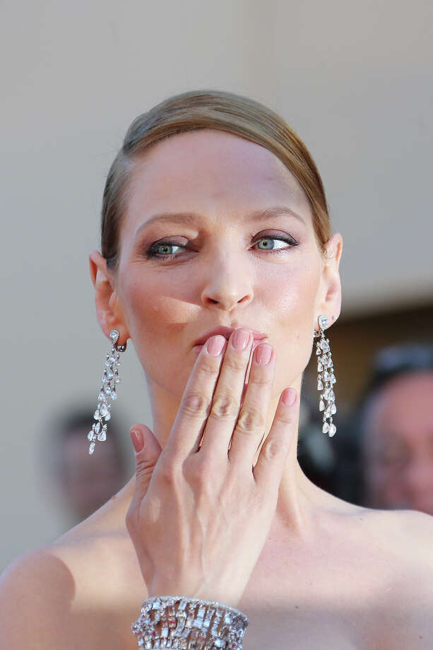 "US actress Uma Thurman blows kisses as she arrives on May 26, 2013 for the screening of the film ""Zulu"" presented Out of Competition at the 66th edition of the Cannes Film Festival in Cannes. Photo: LOIC VENANCE, AFP/Getty Images / 2013 AFP"