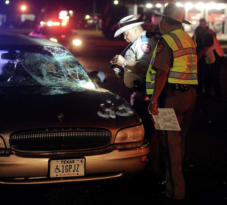 A Port Arthur Police officer was struck by the driver side of a Buick while assisting a clean up crew from the Texas Department of Transportation near the intersection of Memorial Boulevard and 26th Street in Port Arthur around 9:30 P.M. on Thursday November 29, 2012.  The officer was taken to St. Elizabeth Hospital in Beaumont. Photo taken: Randy Edwards/The Enterprise