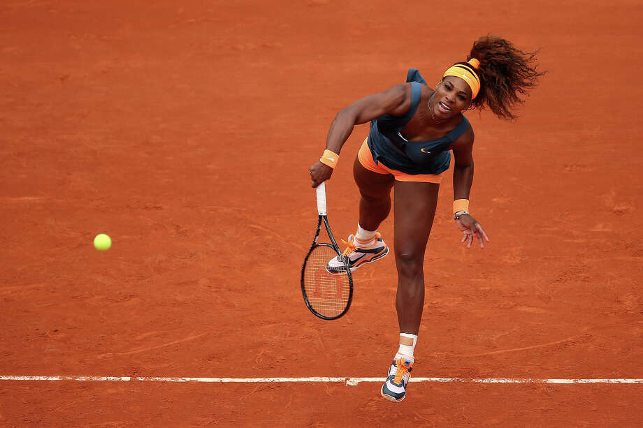 Serena Williams of the United States of America serves in her Women's Singles match against Anna Tatishvili of Georgia during day one of the French Open at Roland Garros on May 26, 2013 in Paris, France. Photo: Clive Brunskill, Getty Images / 2013 Getty Images