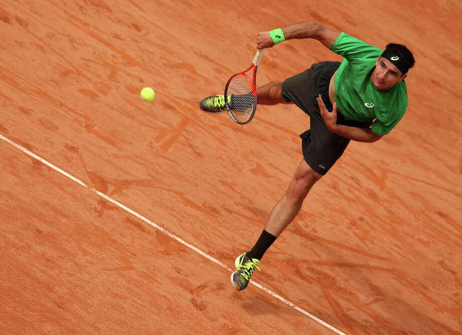 Marinko Matosevic of Australia serves in his Men's Singles match against David Ferrer of Spain during day one of the French Open at Roland Garros on May 26, 2013 in Paris, France. Photo: Matthew Stockman, Getty Images / 2013 Getty Images