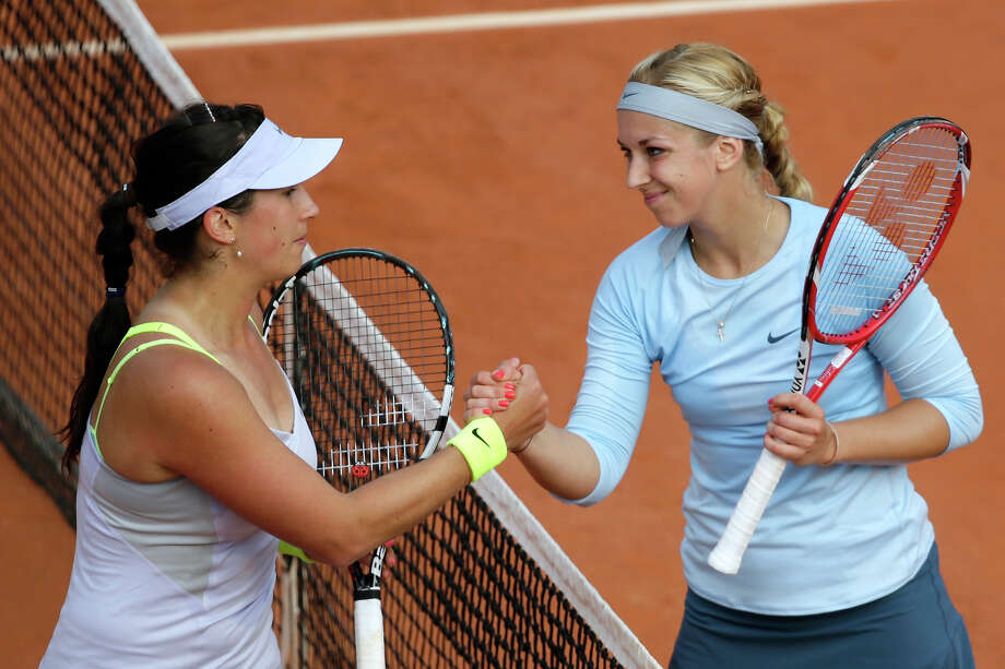 Germany's Sabine Lisicki (R) shakes hands with Sweden's Sofia Arvidsson after winning  their French Tennis Open first round match at the Roland Garros stadium in Paris, on May 26,  2013. Photo: KENZO TRIBOUILLARD, AFP/Getty Images / 2013 AFP