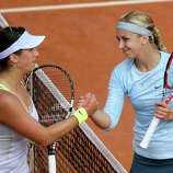 Germany's Sabine Lisicki (R) shakes hands with Sweden's Sofia Arvidsson after winning  their French Tennis Open first round match at the Roland Garros stadium in Paris, on May 26,  2013.