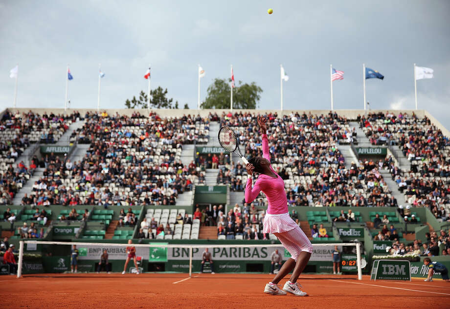 Venus Williams of the United States of America serves during her women's singles match against Urszula Radwanska of Poland on day one of the French Open at Roland Garros on May 26, 2013 in Paris, France. Photo: Matthew Stockman, Getty Images / 2013 Getty Images