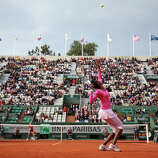 Venus Williams of the United States of America serves during her women's singles match against Urszula Radwanska of Poland on day one of the French Open at Roland Garros on May 26, 2013 in Paris, France.