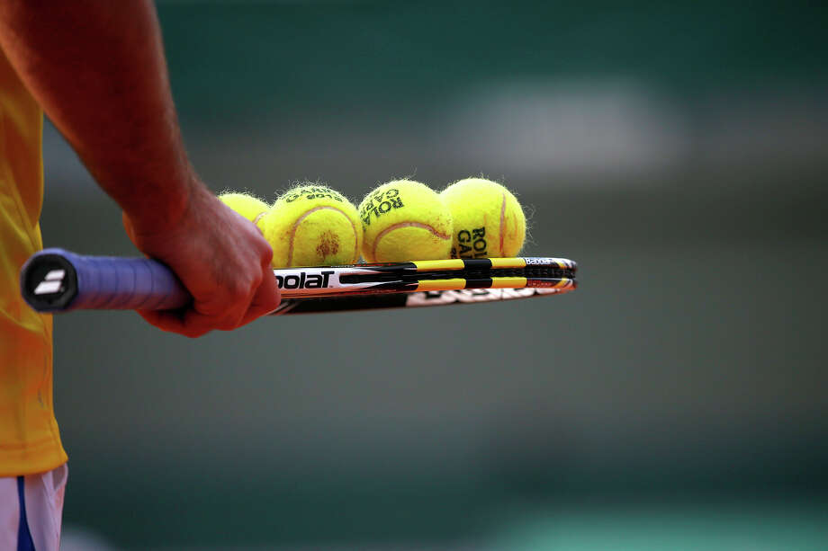 Serbia's Viktor Troicki holds balls on his racket during their French Tennis Open first round match at the Roland Garros stadium in Paris, on May 26,  2013. Photo: THOMAS COEX, AFP/Getty Images / 2013 AFP