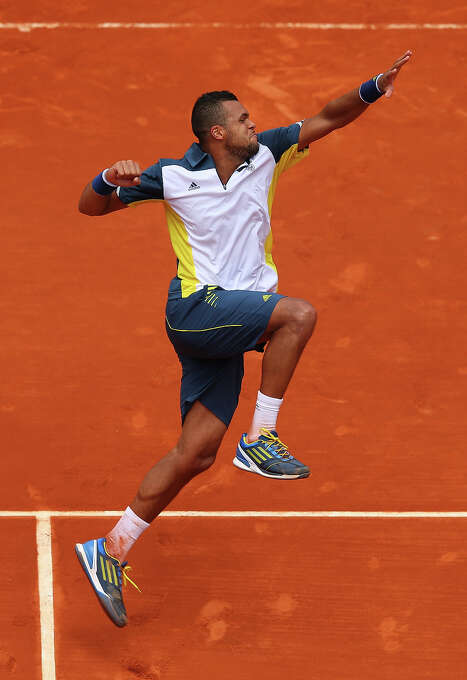 Jo-Wilfried Tsonga of France celebrates match point in his Men's Singles match against Aljaz Bedene of Slovenia during day two of the French Open at Roland Garros on May 27, 2013 in Paris, France. Photo: Julian Finney, Getty Images / 2013 Getty Images