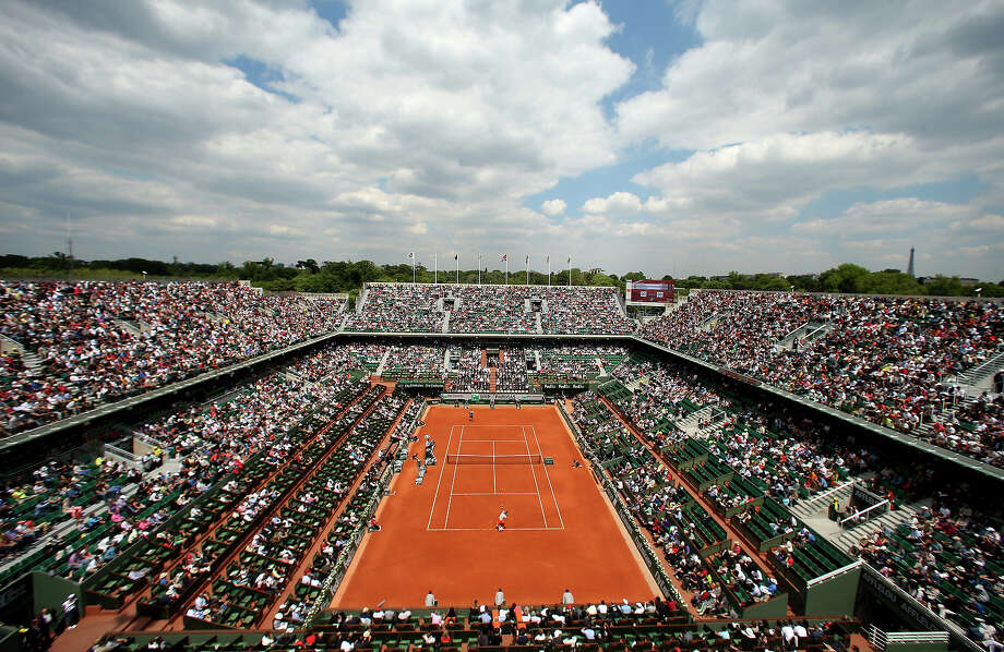 A general view over Philippe Chatrier court as Rafael Nadal of Spain serves in his Men's Singles match against Daniel Brands of Germany during day two of the French Open at Roland Garros on May 27, 2013 in Paris, France. Photo: Matthew Stockman, Getty Images / 2013 Getty Images